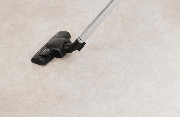 nederste delen av en støvsuger på et gulv